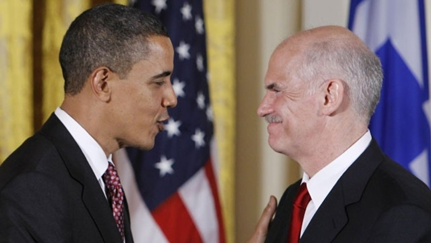 March 9: President Barack Obama shakes hands with Prime Minister George Papandreou of Greece after remarks at a reception in the East Room of the White House.