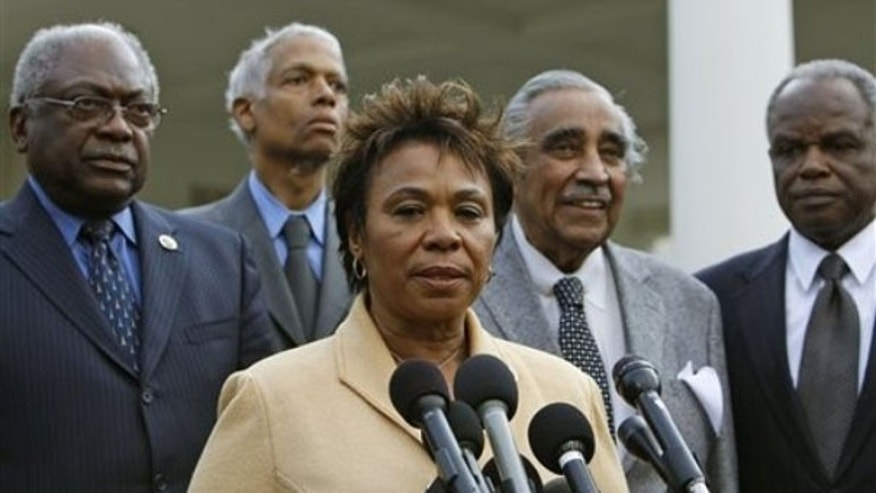 Rep. Barbara Lee, center, accompanied by fellow members of the Congressional Black Caucus, speaks to reporters outside the White House March 11. (AP Photo)