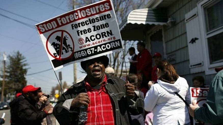 Demonstrators from ACORN's Home Defenders rally outside the foreclosed home of Marie Elie in Elmont, New York, April 9, 2009. (Reuters)