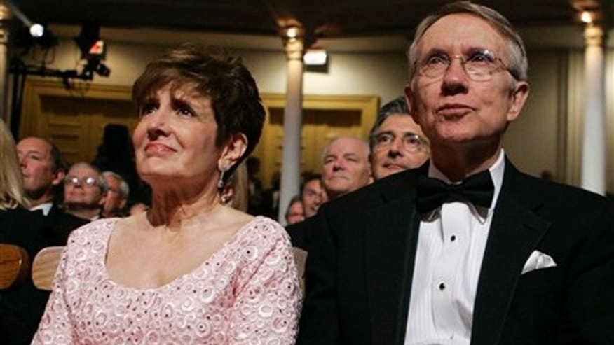 In this June 24, 2007, file photo, Senate Majority Leader Harry Reid, D-Nev., right, and his wife Landra Reid attend an event at Ford's Theater in Washington. (AP)
