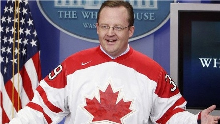 Friday: White House Press Secretary Robert Gibbs dons the Canadian hockey team jersey from the Winter Olympics as part of his losing a bet on the game between Canada and the U.S. (AP).