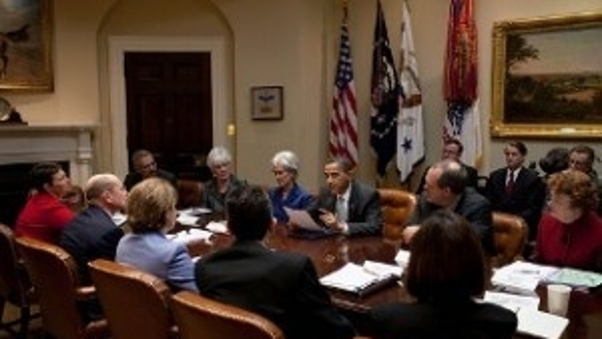 President Obama reads Natoma Canfield's letter to insurance executives March 4th. (White House Photo)