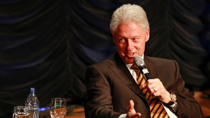 "Former President Bill Clinton answers questions after giving the keynote address at the ""25 Years of Dot Com Policy Impact Forum,"" in Washington, on Tuesday, March 16, 2010. (AP)"