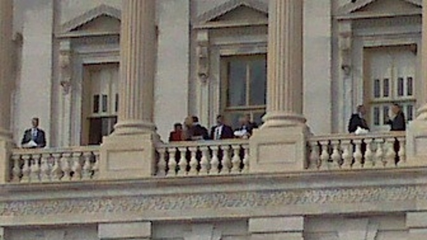 Sunday: Lawmakers look out from the Capitol Balcony before voting on a health insurance overhaul. (AP)