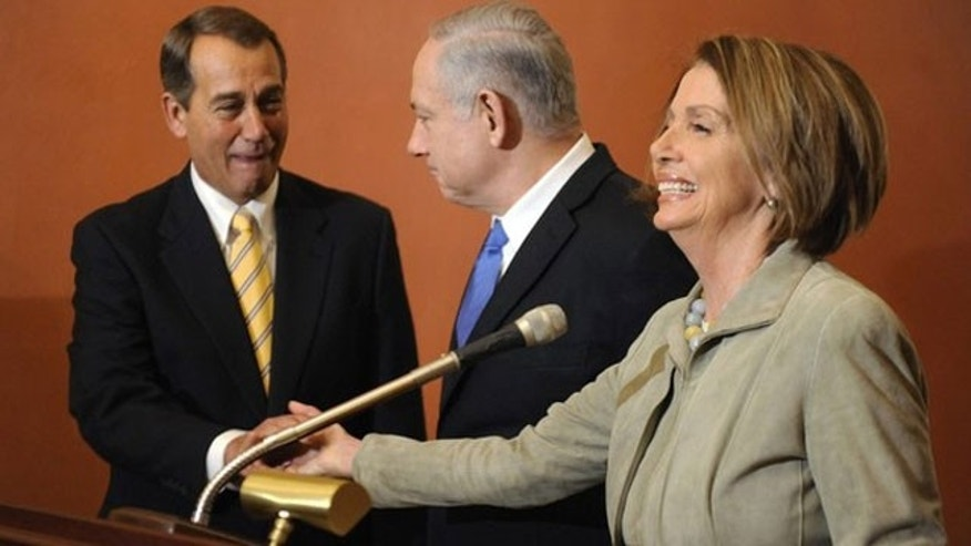 March 23: House Minority Leader John Boehner (R-OH) (L) and House Speaker Nancy Pelosi (D-CA) (R) shake hands across Israeli Prime Minister Benjamin Netanyahu (C) to show their unity on the importance of the U.S.-Israel relationship, during remarks to reporters at the U.S. Capitol in Washington.