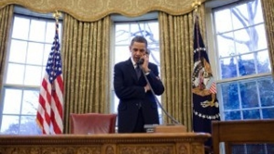 President Barack Obama discusses the START treaty, during a phone call with President Dmitry Medvedev of Russia in the Oval Office, March 26, 2010. (Official White House Photo by Pete Souza)