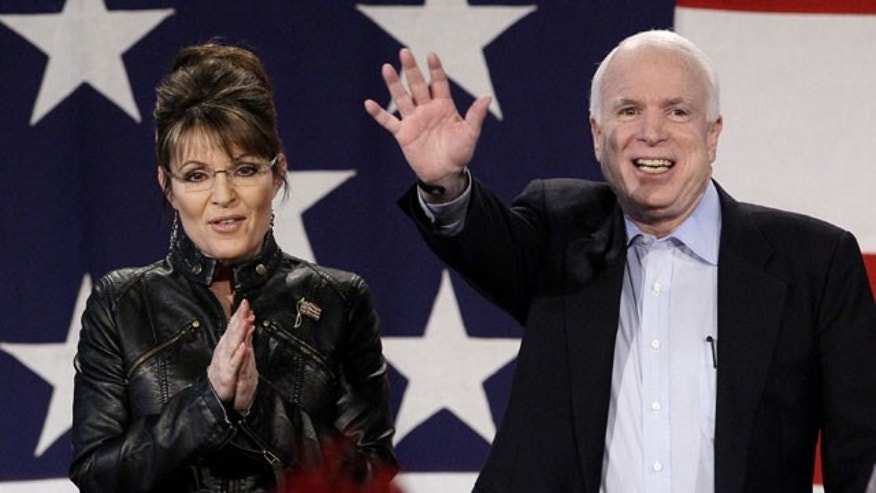 March 26: Sen. John McCain, R-Ariz., is joined on stage by Sarah Palin as she makes an appearance with him at a rally at the Pima County Fairgrounds in Tucson, Ariz.