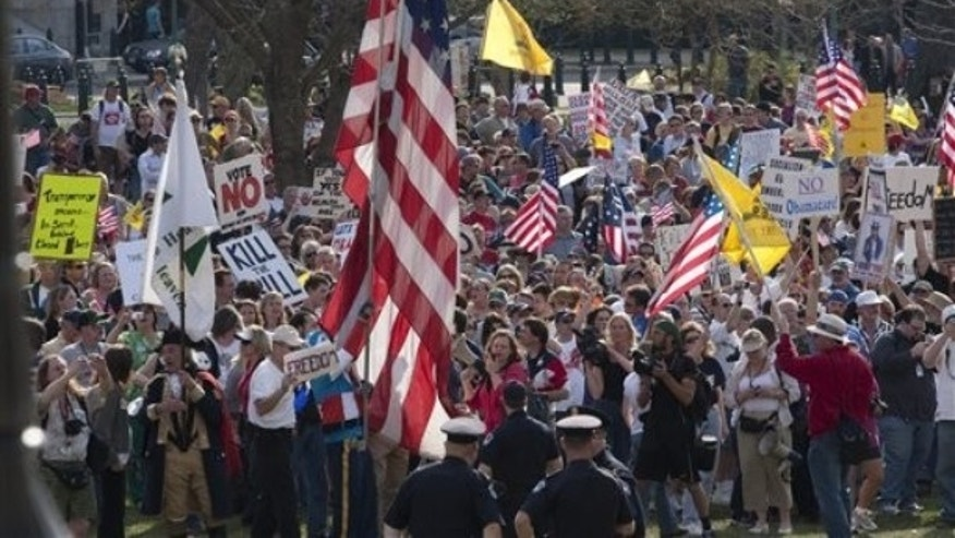 March 20: Tea Party demonstrators march outside of the House Chamber on Capitol Hill in Washington. (AP)