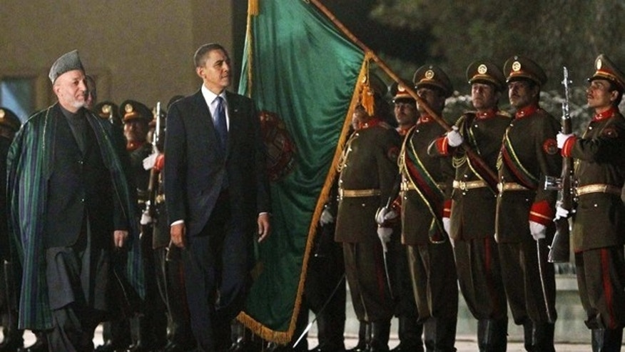 Sunday: President Obama inspects a guard of honor with Afghan President Hamid Karzai at the Presidential Palace in Kabul, where Obama arrived unannounced for his first visit to the war zone since his election as U.S. commander-in-chief. (Reuters)