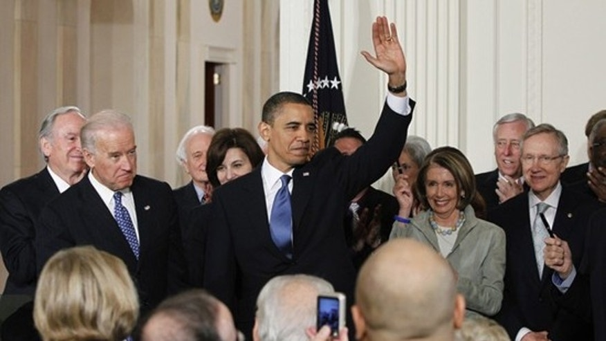 Mar. 23: President Obama waves after signing the comprehensive health care reform legislation in the White House.