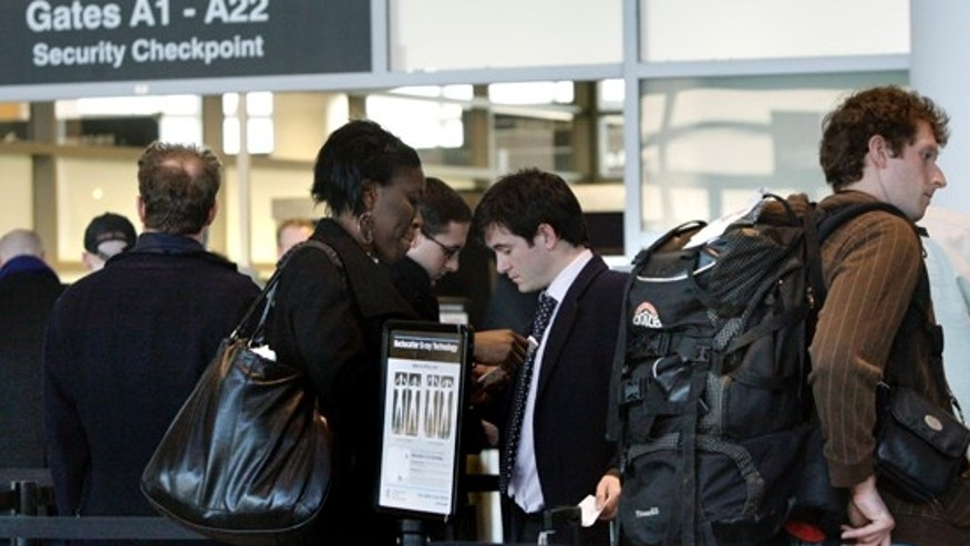 In this March 8, 2010 photo, travelers wait in line prior to entering a security checkpoint at Logan International Airport in Boston. (AP)