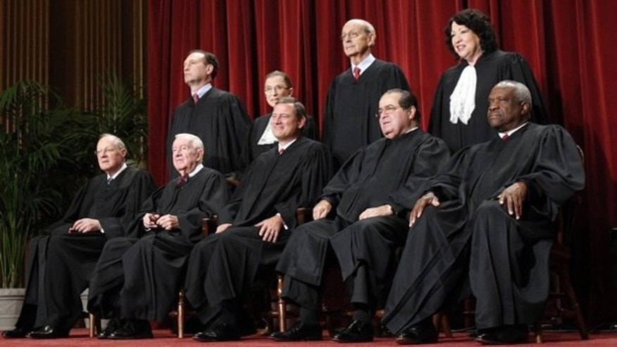Supreme Court justices gather for an official picture at the Supreme Court in Washington Sept. 29, 2009. (Reuters Photo)