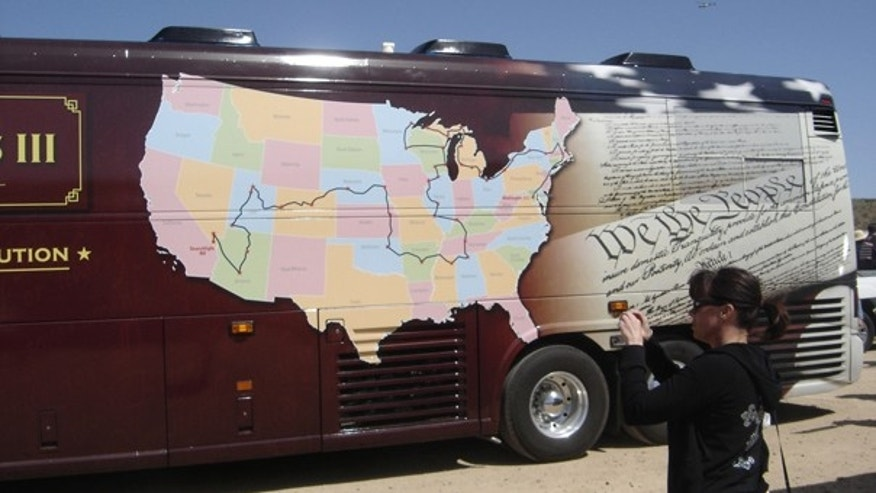 An onlooker takes a photo of the Tea Party Express bus March 28 in Henderson, Nev. (FoxNews.com)