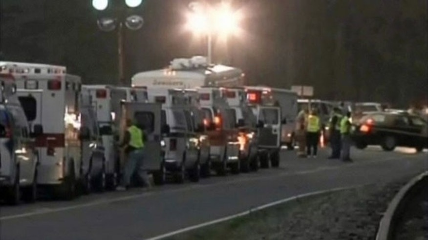 April 5: A row of ambulances waits at the scene of a mining accident at the Upper Big Branch Mine in Montcoal, West Virginia. Rescuers were searching for missing coal miners after an explosion killed 25 of their colleagues at the mine owned by Massey Energy.