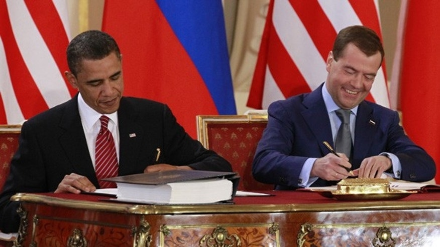 FILE: In this April 8, 2010, photo, President Obama signs the New START treaty with Russian President Dmitry Medvedev at the Prague Castle.
