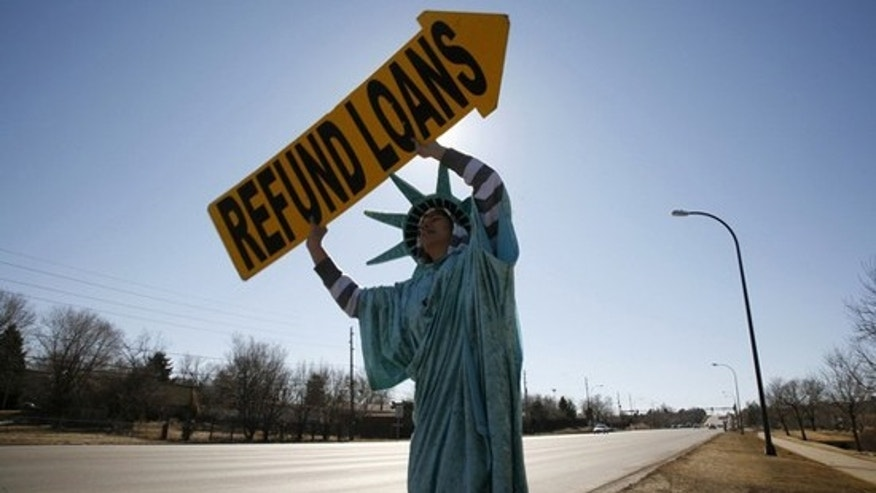 Nathan Peterson of Liberty Tax Services, dressed as the Statue of Liberty, waves a sign at drivers in Westminster, Colorado February 4, 2009. (Reuters)