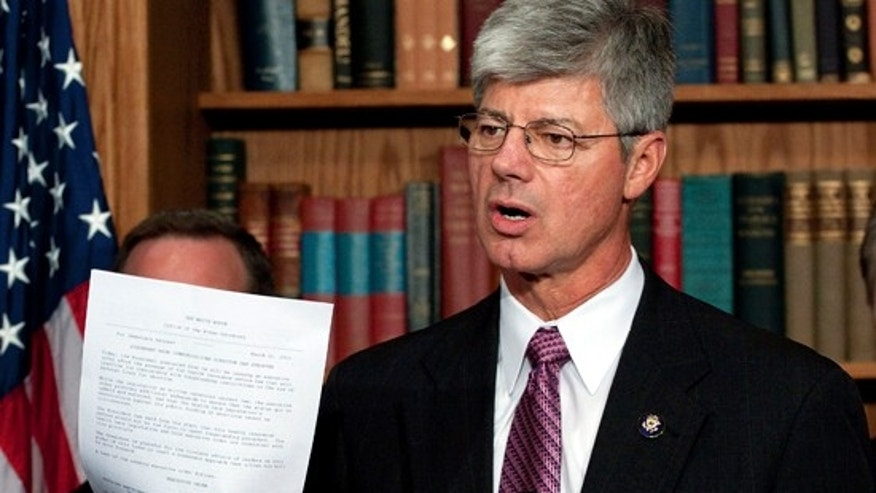 FILE: Rep. Bart Stupak, D-Mich., holds up an executive order to be signed by President Obama reaffirming a ban on the use of federal funds to provide abortions, an order Stupak wanted in exchange for his vote to pass the health insurance overhaul. (AP Photo)