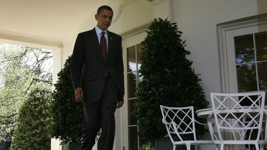 April 9: President Barack Obama walks out of the Oval Office to the Rose Garden of the White House in Washington.