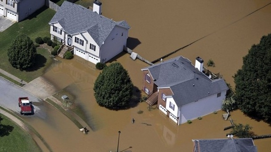 Shown here are homes in the Sweetwater Creek area of Atlanta, Ga., submerged in flood waters Sept. 23, 2009. (Reuters Photo)