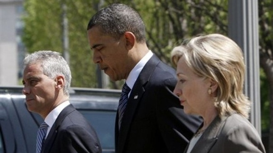 President Obama walks out of the White House with Secretary of State Hillary Clinton and White House Chief of Staff Rahm Emanuel in advance of the Nuclear Security Summit April 11. (AP Photo)