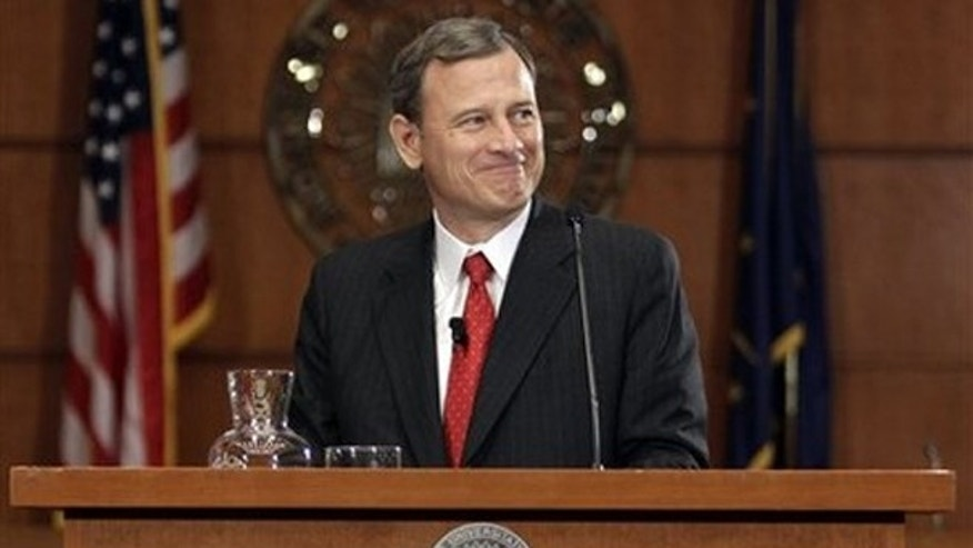 Wednesday: Chief Justice of the Supreme Court John Roberts speaks at the Indiana University School of Law in Indianapolis.  (AP Photo)