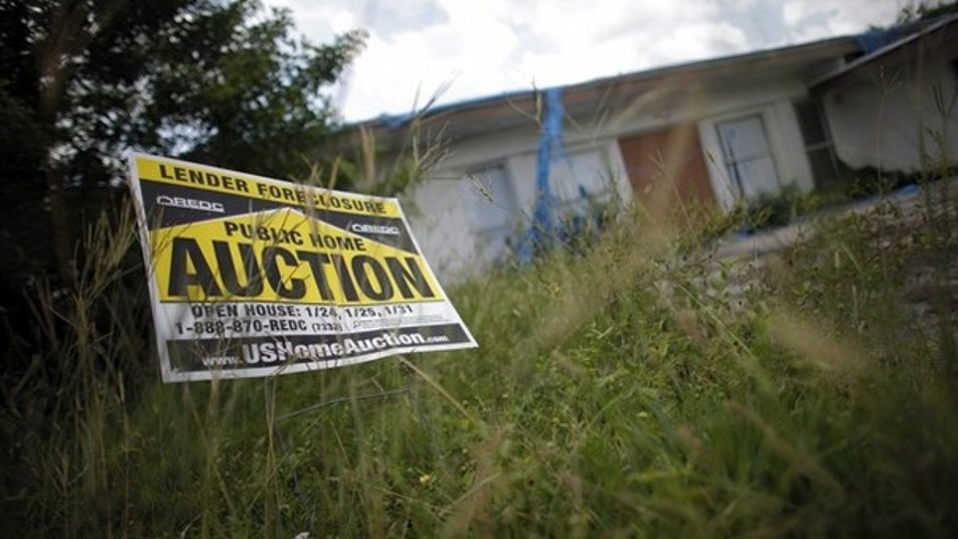 An auction sign for a property is seen at the front garden of a foreclosed house in Miami Gardens, Fla., in this Sept. 15, 2009, file photo. (Reuters Photo)