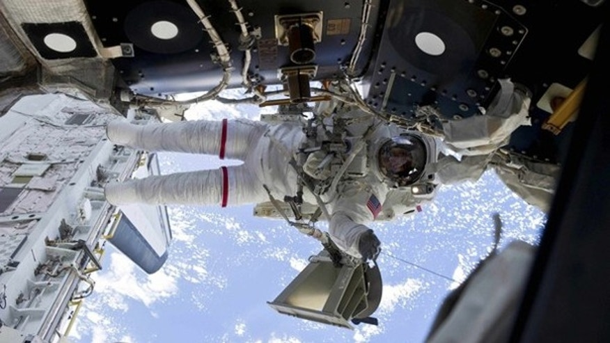Astronaut Rick Mastracchio is shown participating in a spacewalk in this image provided by NASA and taken April 13.