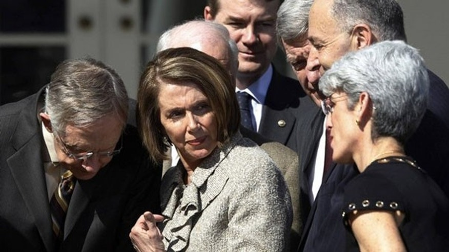 House Speaker Nancy Pelosi confers with Senate Majority Leader Harry Reid and Sen. Chuck Schumer in the Rose Garden March 18. (Reuters Photo)
