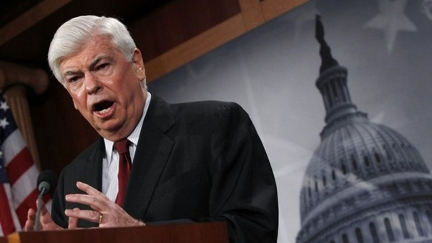 Sen. Chris Dodd unveils his financial reform bill on Capitol Hill March 15. (Reuters Photo)