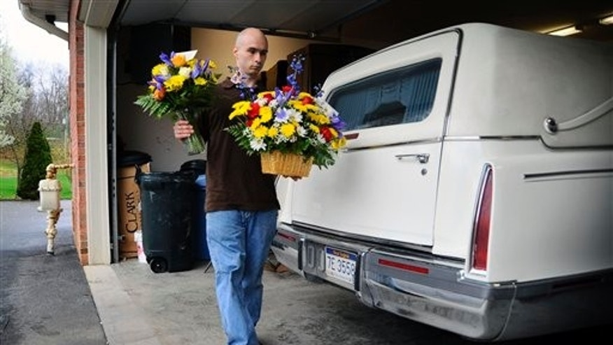 April 8: A florist delivers flowers for deceased coal miner Steven Harrah, 40, of Cool Ridge, W.Va.