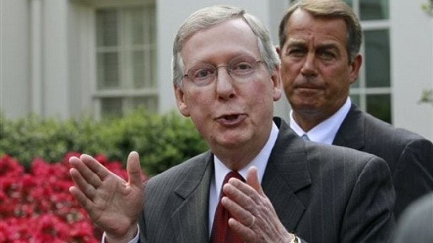Senate Minority Leader Mitch McConnell, accompanied by House Minority Leader John Boehner, talks to reporters outside the White House April 14. (AP Photo)