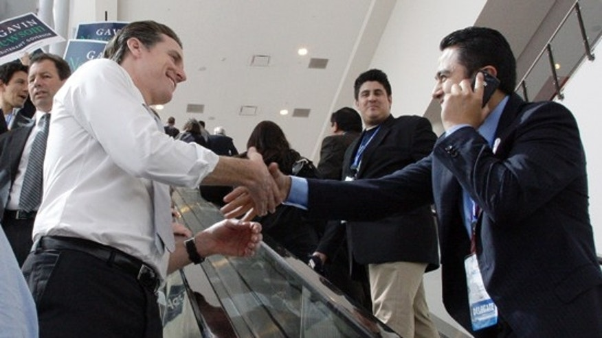 San Francisco Mayor and candidate for Lieutenant Governor Gavin Newsom greets a delegate across an escalator at the California Democratic Convention in Los Angeles Saturday, April 17, 2010. (AP)