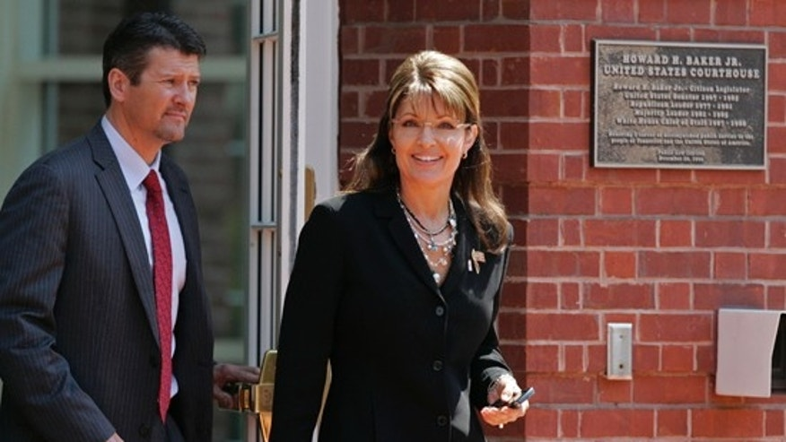 Friday: Former Alaska Gov. Sarah Palin leaves the Federal Courthouse in Knoxville, Tenn., with her husband Todd Palin. (AP)
