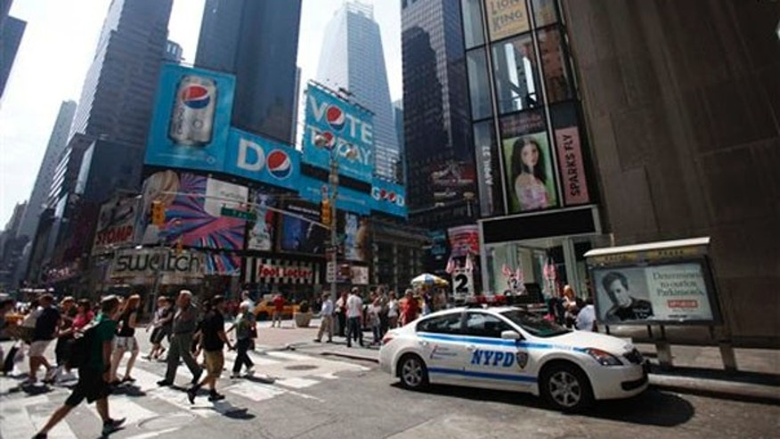 A police car is parked near the spot where a car bomb was discovered the night before in Times Square in New York May 2. (AP Photo)