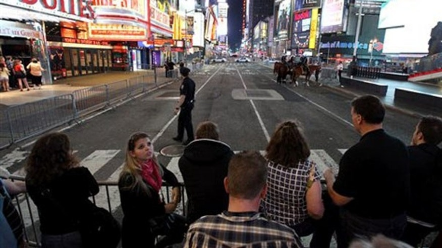 Police are seen closing some streets in New York City's Times Square as they investigate a suspicious vehicle found to be carrying explosive material. (AP Photo)