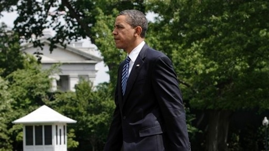 President Obama returns to the White House after speaking at the University of Michigan in Ann Arbor May 1. (AP Photo)