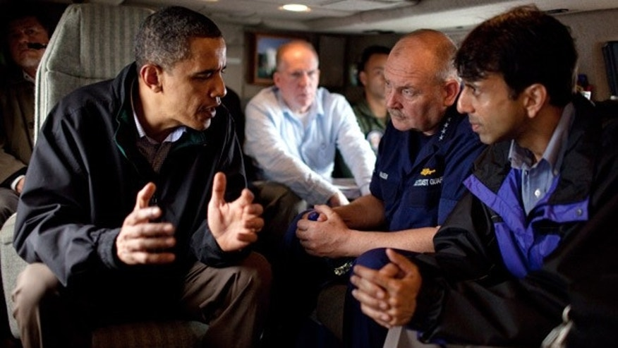FILE: President Obama talks with U.S. Coast Guard Commandant Adm. Thad Allen and Louisiana Gov. Bobby Jindal aboard Marine One on May 2 as they fly along the coastline from Venice, La.