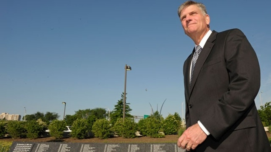 May 6: Rev. Franklin Graham prepares to leave the Pentagon.  Earlier, Graham prayed on a sidewalk outside the Pentagon after having being disinvited inside because of comments that insulted people of other religions.