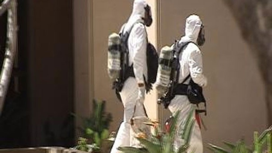 May 5: Hazmat teams enter the Capitol Tower in Phoenix after a suspicious envelope packed with white powder was sent to Arizona Gov. Jan Brewer's office.