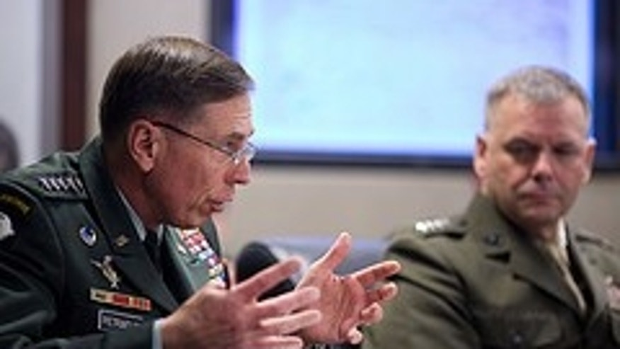 General David Petraeus, Commander, U.S. Central Command, left, gestures during a meeting on Afghanistan and Pakistan with President Barack Obama and the national security team in the Situation Room of the White House, May 6, 2010. At right is General James E. Cartwright, USMC, Vice Chairman, Joint Chiefs of Staff. (Official White House Photo by Pete Souza)