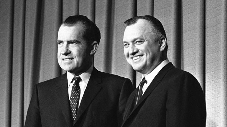 In this file photo from Dec. 11, 1968, President Richard Nixon, left, is shown with Secretary of Interior Walter J. Hickel at Nixon's announcement of cabinet in Washington.