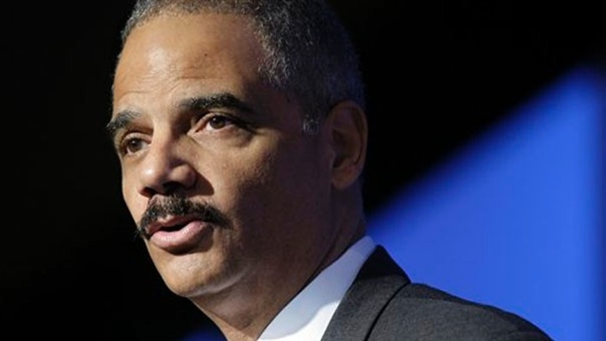 Attorney General Eric Holder addresses the National Conference on Human Trafficking in Arlington, Va., May 3. (AP Photo)