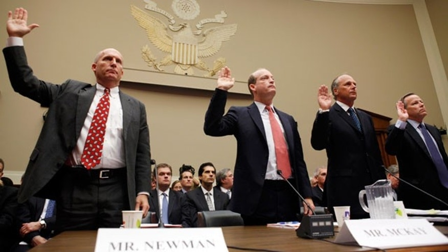 May 12: Steven Newman, President and Chief Executive Officer Transocean Limited, Lamar McKay, President and Chairman of BP America, Inc., Timothy Probert, President, Global Business Lines, and Chief Health, Safety, and Environmental Officer, Halliburton, and Jack Moore, President and Chief Executive Officer, Cameron, are sworn in before they testify during a House subcommittee hearing on the Gulf Coast oil spill. (AP)