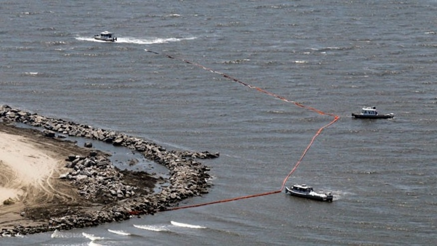May 10: Boats work with containment boom on the shoreline of Grand Isle, La. (AP)