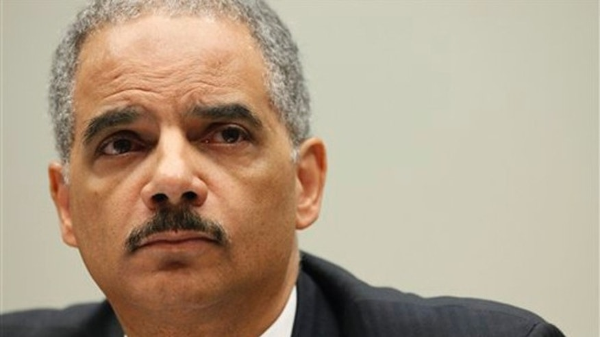 Attorney General Eric Holder testifies before the House Judiciary Committee May 13 on Capitol Hill. (AP Photo)