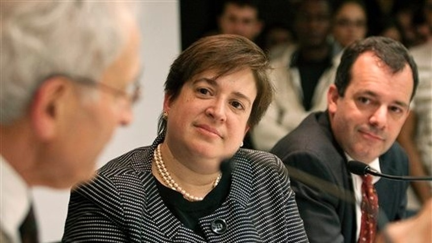 This Sept. 11, 2009 photo released by the Harvard University Law School shows U.S. Solicitor General and former Dean of Harvard Law School Elena Kagan listening to law professor Charles Fried, left, alongside law professor John F. Manning, right, on the university campus in Cambridge, Mass.
