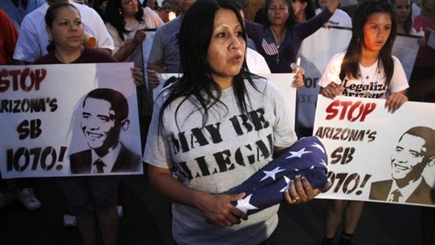 Demonstrators march to Arizona's State Capitol to protest the state's immigration law in Phoenix May 5. (Reuters Photo)