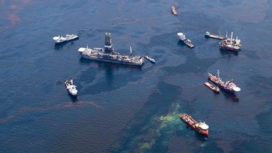 May 18: Ships make their way through surface oil near a barge funnelling off oil from the Deepwater Horizon wellhead in this aerial view over the Gulf of Mexico. Fears that ocean currents were spreading oil from the Gulf of Mexico spill flared on Tuesday after tar balls turned up in Florida, raising pressure on energy giant BP to capture more of the leaking crude (Reuters).
