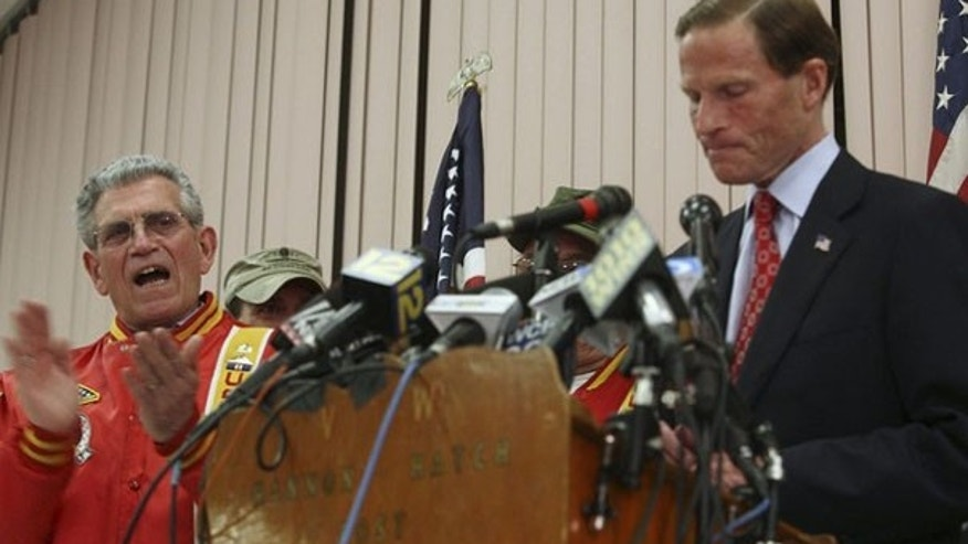 Connecticut Attorney General Richard Blumenthal, right, addresses allegations that he lied about serving in Vietnam during a news conference in West Hartford, Conn., May 18. (Reuters Photo)