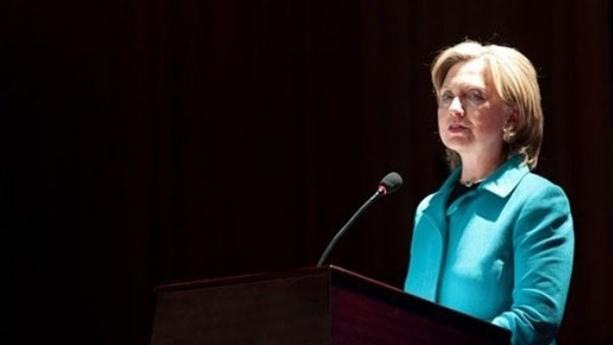 Secretary of State Hillary Clinton speaks before signing an agreement at the National Center for the Performing Arts in Beijing May 25. (AP Photo)